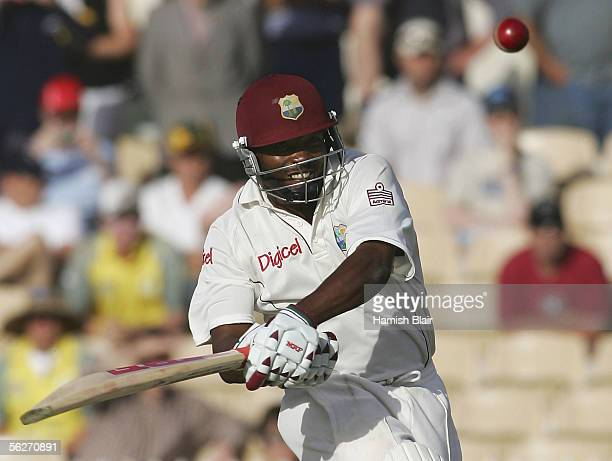 Brian Lara of the West Indies hits a four to bring up his double century during day one of the Third Test between Australia and the West Indies...