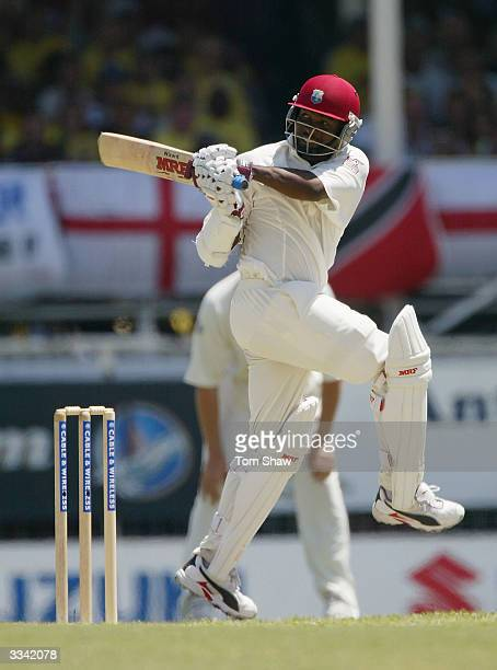 Brian Lara of the West Indies hits out on his way past the previous world record that of Matthew Hayden of Australia on 380 during day three of the...