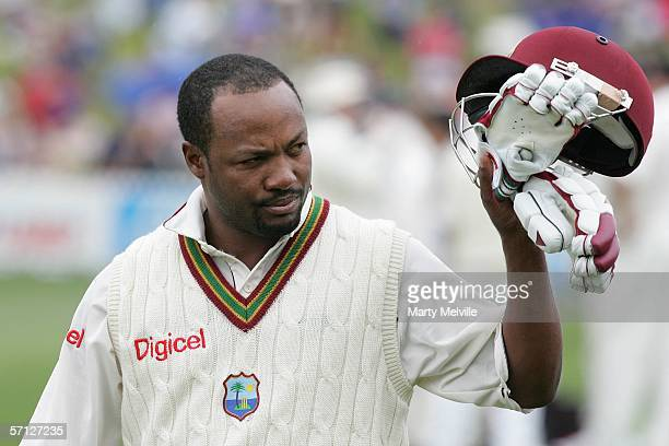 Brian Lara of the West Indies lifts his cap to the crowd as he leaves the field after being caught out for one run by Hamish Marshall of the New...