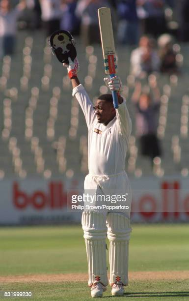 Brian Lara of Warwickshire celebrates his record score of 501 not out in the Britannic Assurance County Championship match between Warwickshire and...