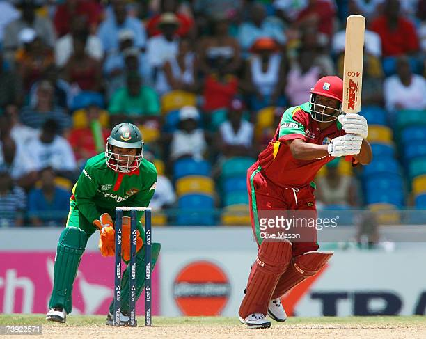 Brian Lara of West Indies hits out watched by Mushfiqur Rahim of Bangladesh during the ICC Cricket World Cup Super Eights match between West Indies...