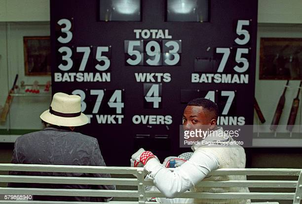 Brian Lara of West Indies poses in the Museum at Lord's Cricket Ground, London, circa June 1995. The scoreboard shows his record Test score of 375...