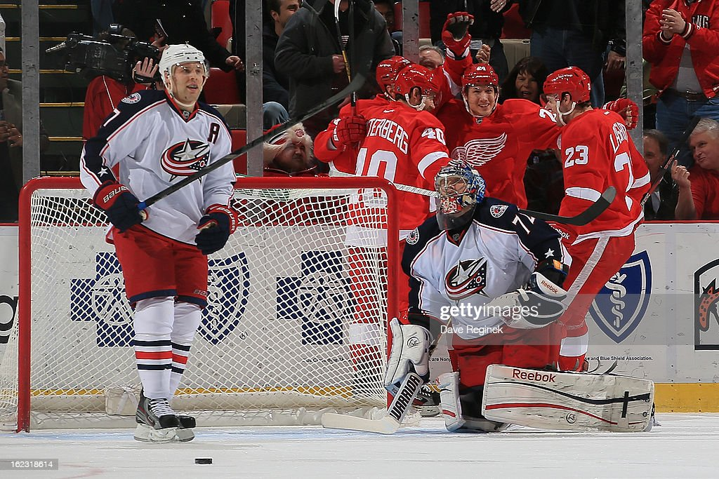 Brian Lashoff #23 of the Detroit Red Wings celebrates his first-period goal with teammates Henrik Zetterberg #40 and Damien Brunner #24 as goaltender Sergei Bobrovsky #72 and Jack Johnson #7 of the Columbus Blue Jackets look away during a NHL game at Joe Louis Arena on February 21, 2013 in Detroit, Michigan. Columbus won 3-2