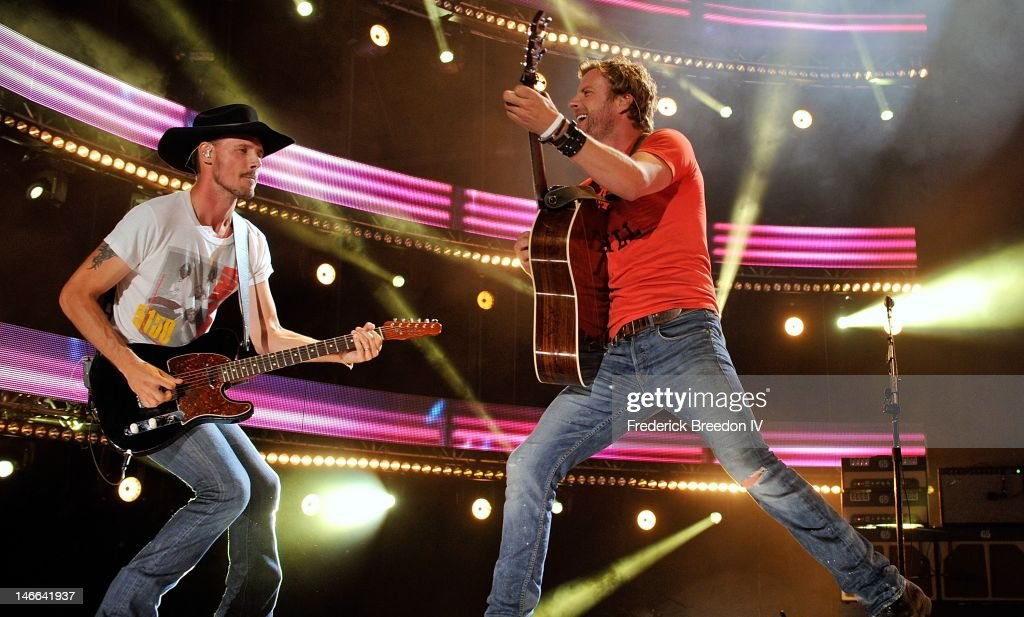 Brian Layson and Dierks Bentley perform on stage at LP Field during the 2012 CMA Music Festival on June 10, 2012 in Nashville, Tennessee.