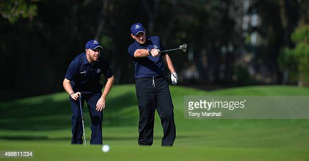 Brian Lee of Parc Golf Club and Carl Hicks Captain of Parc Golf Club line up a putt during the second round of the Golfplan Insurance PGA ProCaptain...