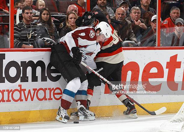 Brian Lee of the Ottawa Senators battles for the puck against Matt Duchene of the Colorado Avalanche during the NHL action at Scotiabank Place on...