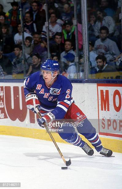 Brian Leetch of the New York Rangers skates with the puck during an NHL game against the against the New York Islanders on March 28 1992 at the...