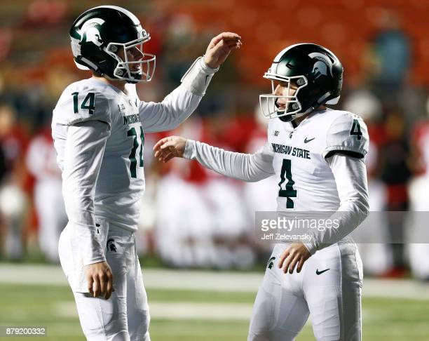 Brian Lewerke of celebrates with Matt Coghlin of the Michigan State Spartans during their game on November 25 2017 in Piscataway New Jersey