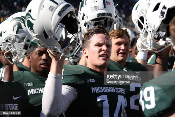 Brian Lewerke of the Michigan State Spartans celebrates a 3120 win over the Central Michigan Chippewas at Spartan Stadium on September 29 2018 in...