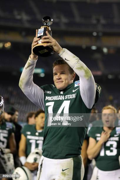 Brian Lewerke of the Michigan State Spartans is named offensive player of the game after defeating the Washington State Cougars 4217 in the SDCCU...