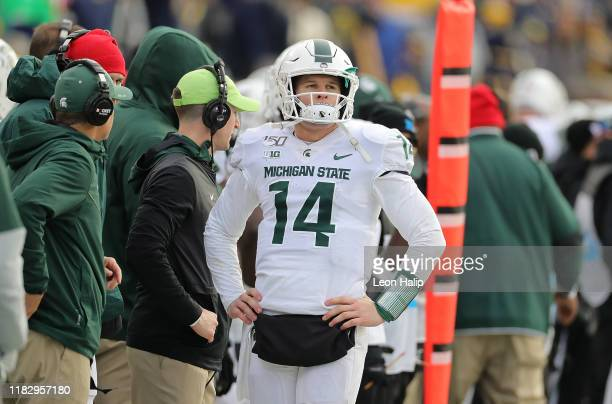 Brian Lewerke of the Michigan State Spartans jogs off the field after a failed fourth down conversion during the fourth quarter of the game against...