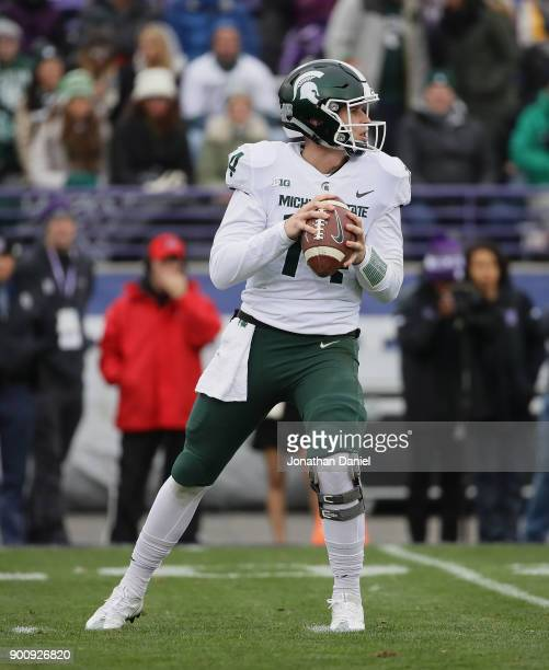 Brian Lewerke of the Michigan State Spartans looks for a receiver against the Northwestern Wildcats at Ryan Field on October 28 2017 in Evanston...
