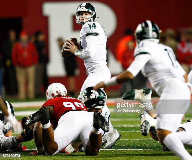 Brian Lewerke of the Michigan State Spartans looks to pass against the Rutgers Scarlet Knights during their game on November 25 2017 in Piscataway...