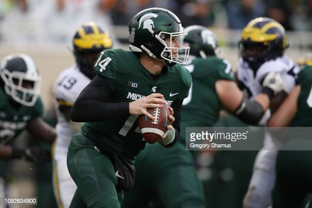 Brian Lewerke of the Michigan State Spartans looks to pass during the second half while playing the Michigan Wolverines at Spartan Stadium on October...