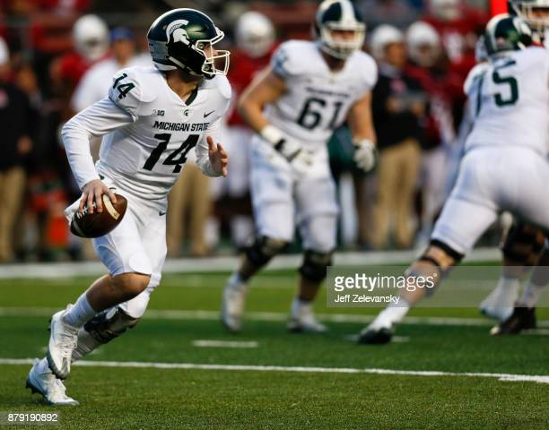 Brian Lewerke of the Michigan State Spartans rolls out against the Rutgers Scarlet Knights during their game on November 25 2017 in Piscataway New...