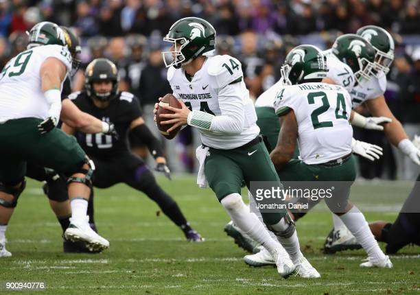 Brian Lewerke of the Michigan State Spartans rolls out to look for a receiver against the Northwestern Wildcats at Ryan Field on October 28 2017 in...