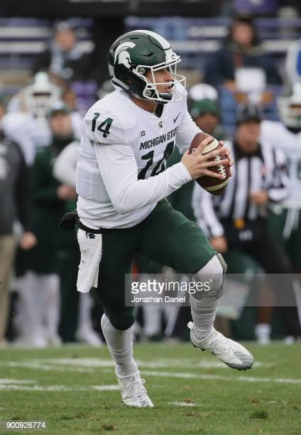 Brian Lewerke of the Michigan State Spartans runs against the Northwestern Wildcats at Ryan Field on October 28 2017 in Evanston Illinois...
