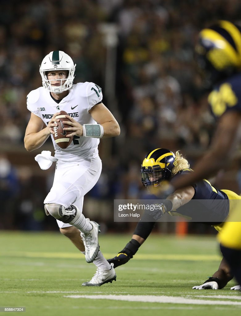 Brian Lewerke #14 of the Michigan State Spartans runs for a first down during the second quarter of the game against the Michigan Wolverines at Michigan Stadium on October 7, 2017 in Ann Arbor, Michigan. Michigan State defeated Michigan 14-10.