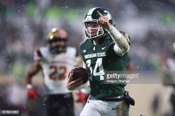 Brian Lewerke of the Michigan State Spartans runs for a first half touchdown in front of Isaiah Davis of the Maryland Terrapins at Spartan Stadium on...
