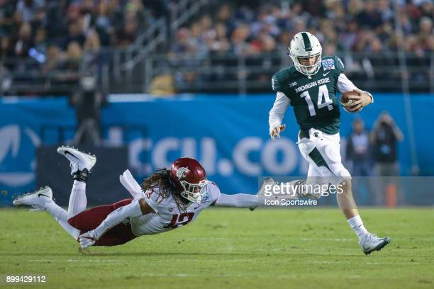 Brian Lewerke of the Michigan State Spartans runs for a gain in the game between the Washington State Cougars and the Michigan State Spartans in the...
