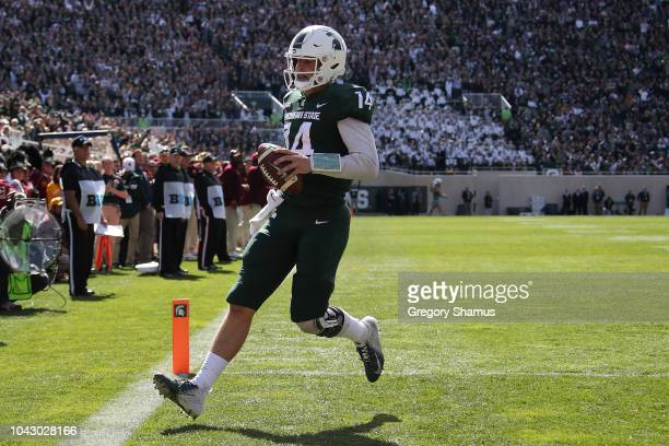 Brian Lewerke of the Michigan State Spartans scores a first half touchdwon while playing the Central Michigan Chippewas at Spartan Stadium on...
