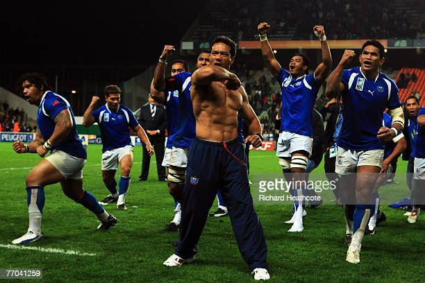 Brian Lima leads The Samoan team in The Siva Tau after match thirty two of the Rugby World Cup 2007 between Samoa and USA at the Stade Geoffroy...