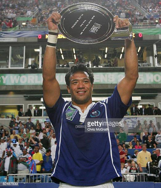 Brian Lima of Samoa holds aloft the Plate after defeating Portugal in the Plate Final on day three of the Rugby World Cup Sevens held at Hong Kong...