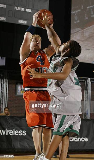 Brian Litrell of the Backstreet Boys shoots over Bow Wow at the Jeep celebrity 3 on 3 game on February 9 2003 at the NBA All Star 2003 Jam Session in...