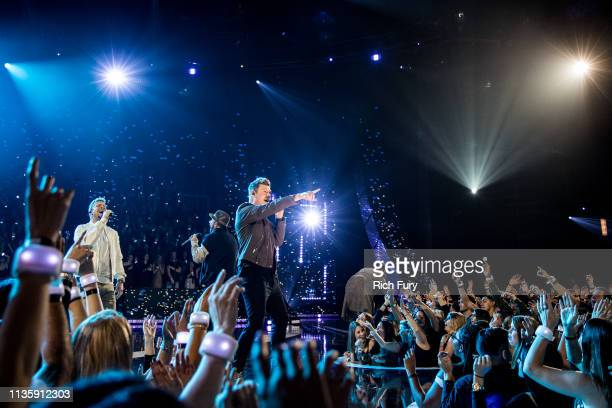 Brian Littrell AJ McLean Nick Carter and Kevin Richardson of Backstreet Boys perform on stage at the 2019 iHeartRadio Music Awards which broadcasted...
