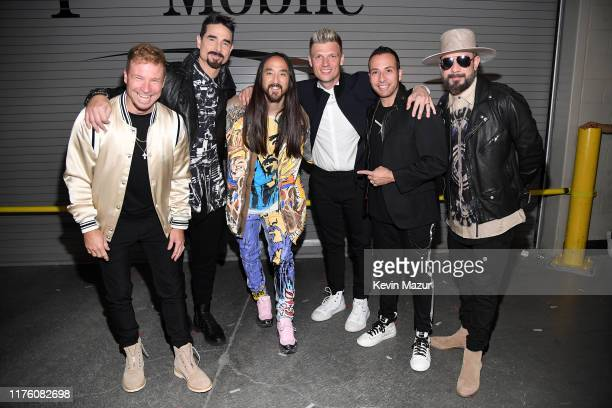 Brian Littrell AJ McLean Steve Aoki Nick Carter Howie Dorough and AJ McLean pose backstage during the 2019 iHeartRadio Music Festival at TMobile...