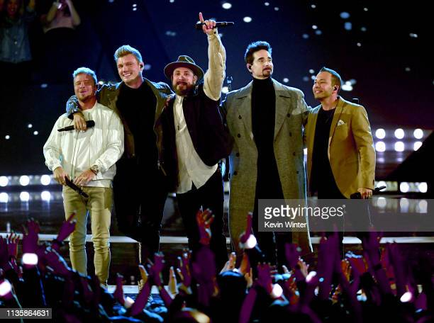 Brian Littrell Nick Carter AJ McLean Kevin Richardson and Howie Dorough of Backstreet Boys perform on stage at the 2019 iHeartRadio Music Awards...