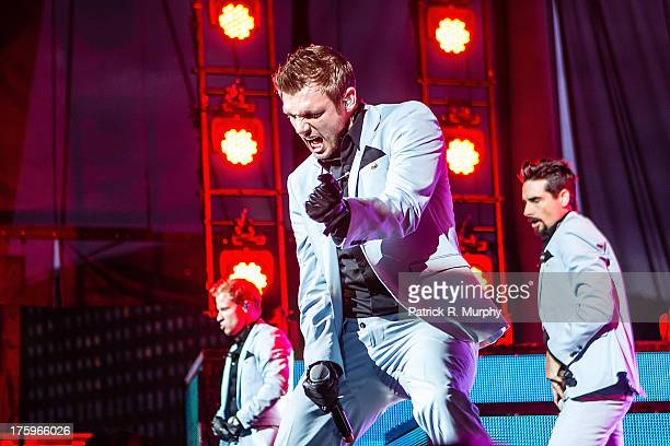 Brian Littrell Nick Carter and Kevin Richardson of the Backstreet Boys perform at Jacobs Pavilion on August 10 2013 in Cleveland Ohio