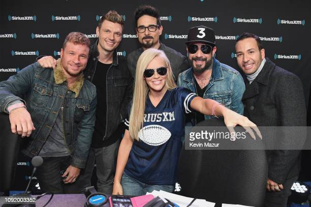 Brian Littrell Nick Carter Kevin Richardson AJ McLean and Howie Dorough of Backstreet Boys pose with Jenny McCarthy during SiriusXM at Super Bowl...
