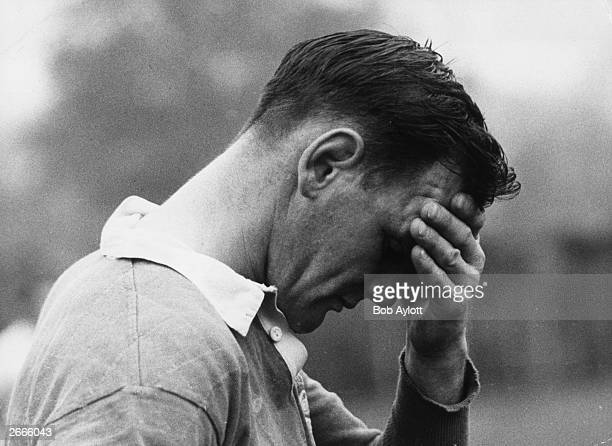 Brian Lochore caprain of the All Blacks, New Zealand rugger team rests his head in his hand after a strenuous training session at Wimbledon before a...