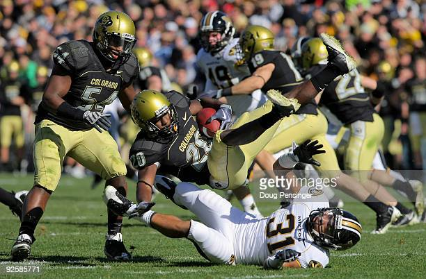 Brian Lockridge of the Colorado Buffaloes returns a kick off and is upended by Trey Hobson of the Missouri Tigers at Folsom Field on October 31 2009...