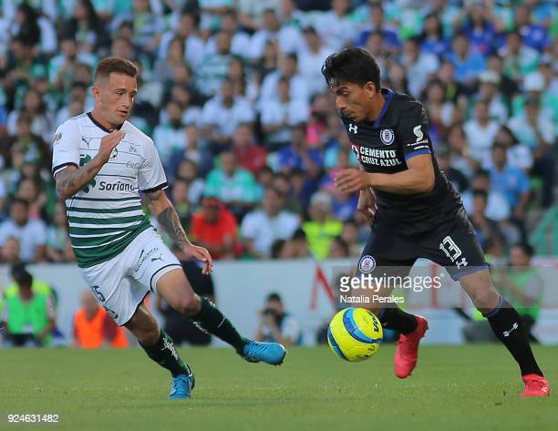 Brian Lozano of Santos and Angel Mena of Cruz Azul fight for the ball during the 9th round match between Santos Laguna and Cruz Azul as part of...