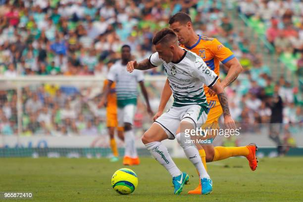 Brian Lozano of Santos and Jesus Duenas of Tigres fight for the ball during the quarter finals second leg match between Santos Laguna and Tigres UANL...