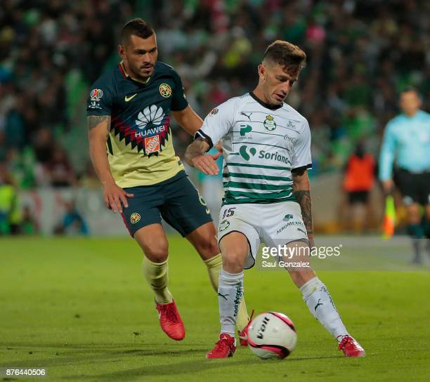 Brian Lozano of Santos and Miguel Samudio of America fight for the ball during the 17th round match between Santos Laguna and America as part of the...