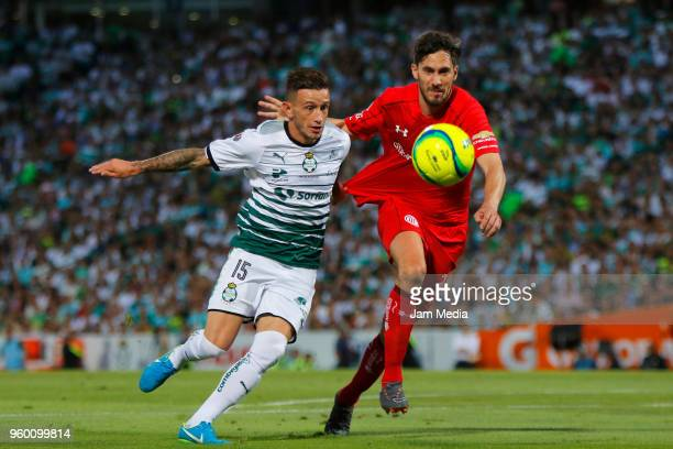 Brian Lozano of Santos and Santiago Garcia of Toluca fight for the ball during the Final first leg match between Santos Laguna and Toluca as part of...