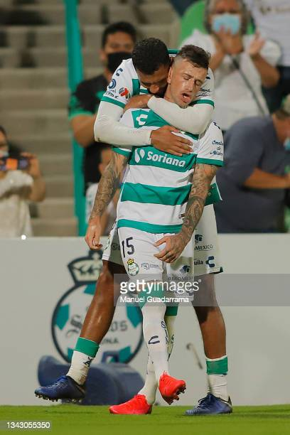 Brian Lozano of Santos celebrates with teammate after scoring the first goal of his team during the 10th round match between Santos Laguna and...