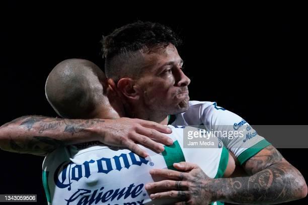 Brian Lozano of Santos celebrates with teammate Matheus Doria after scoring his team's first goal during the 10th round match between Santos Laguna...