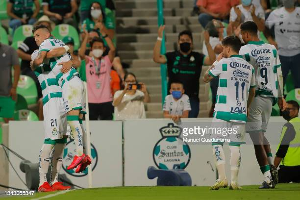 Brian Lozano of Santos celebrates with teammates after scoring the first goal of his team during the 10th round match between Santos Laguna and...
