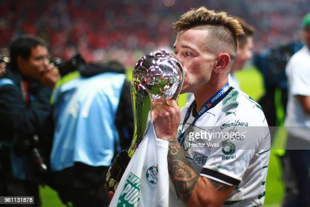 Brian Lozano of Santos Laguna kisses the Championship Trophy after the Final second leg match between Toluca and Santos Laguna as part of the Torneo...