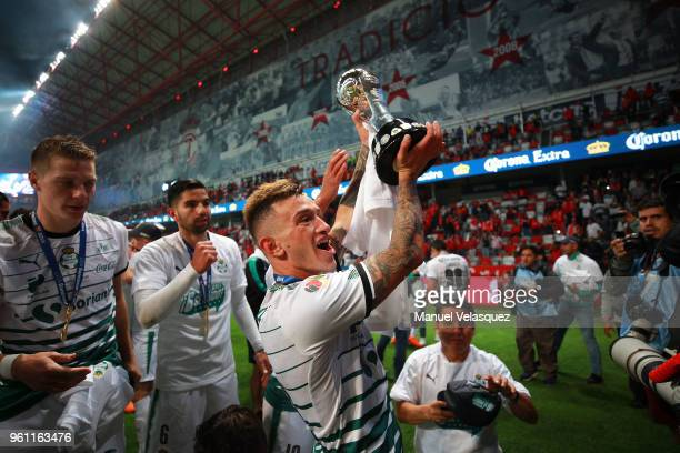 Brian Lozano of Santos lifts the trophy to celebrate after the Final second leg match between Toluca and Santos Laguna as part of the Torneo Clausura...