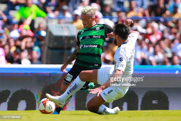 Brian Lozano of Santos struggles for the ball against Luis Quintana of Pumas during the 17th round match between Pumas UNAM vs Santos Laguna as part...