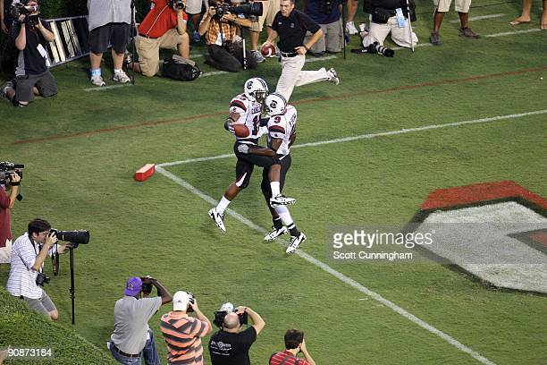 Brian Maddox of the South Carolina Gamecocks is congratulated by Moe Brown after scoring a touchdown against the Georgia Bulldogs at Sanford Stadium...