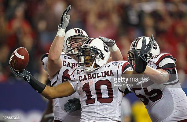 Brian Maddox of the South Carolina Gamecocks reacts after scoring a touchdown against the Florida State Seminoles with Hutch Eckerson and TJ Johnson...