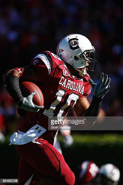 Brian Maddox of the South Carolina Gamecocks runs for a first half touchdown against the Clemson Tigers at WilliamsBrice Stadium on November 28 2009...