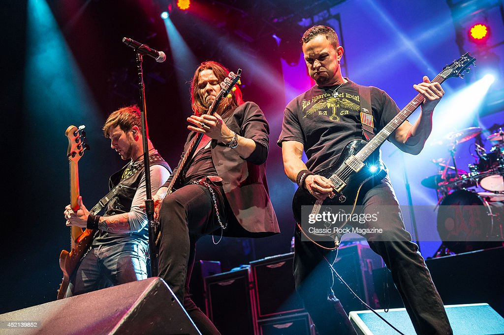 Brian Marshall, Myles Kennedy and Mark Tremonti of American rock group Alter Bridge performing live on stage at Wembley Arena in London, on October 18, 2013.