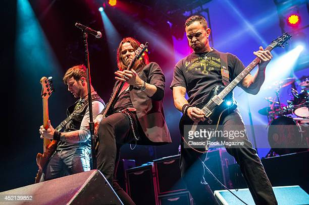 Brian Marshall Myles Kennedy and Mark Tremonti of American rock group Alter Bridge performing live on stage at Wembley Arena in London on October 18...